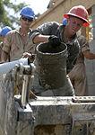 Bond beam work at Gabriela Mistral School construction site 150622-F-LP903-982.jpg