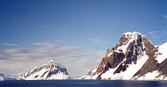 Antarctic Peninsula - Booth Island and Mount Scott flank the narrow Lemaire Channel on the west side of the Antarctic Peninsula, 2001
