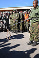 Botswana Defence Force (BDF) Staff Sgt. Gosetsepako Lekgowe, with the snake park at Sir Seretse Khama Barracks, holds a juvenile spitting cobra on the end of a trainer's pole for a snake demonstration for an 120808-Z-VI159-246.jpg