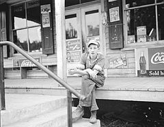 Boy on porch of general store, Roseland, Virginia.jpg