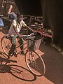 Boy riding through the market.jpg