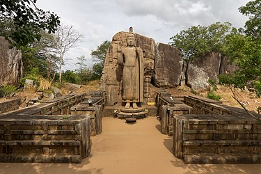 The Avukana Buddha statue, a 12-metre-tall (39 ft) standing Buddha statue from the reign of Dhatusena of Anuradhapura, 5th century Buda de Avukana - 01.jpg