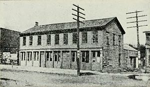 Iowa City, Iowa - Building in which the Iowa Territorial Legislature first met in Iowa City.  Image recorded after the building, which was called Butler's Capitol, had been moved from its original location near Clinton and Washington streets to an alley-side location along Dubuque Street a half-block south of College Street.  In this second location, as shown, it became the notorious City Hotel.