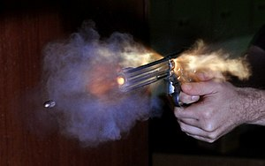 Shooting sports - High-speed photography of the smoke of burnt gunpowder and a .38 Special bullet fired out of a Smith & Wesson Model 686 revolver.