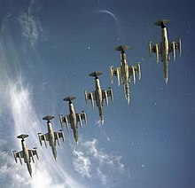 Six F-104Gs flying in formation photographed from below