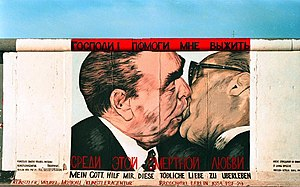 Soviet premier Leonid Brezhnev locked in a mouth-to-mouth kiss with East German leader Erich Honecker above the legend My God, Help Me to Survive This Deadly Love