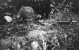 FG 42 - A Fallschirmjäger firing the early FG 42 in June 1944