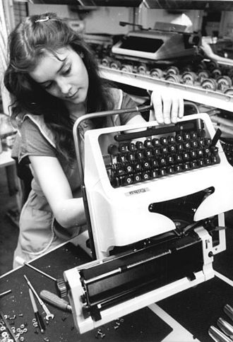 VEB Robotron - One of the 17,000 workers at the Kombinat Robotron in the German Democratic Republic in 1987 working during the weekend to produce typewriters