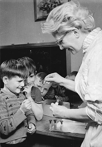 Cold War tensions and the polio vaccine - Kindergarten children receive oral polio vaccine in 1960 in East Germany.