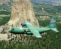 C-130B Wyoming ANG flying past DevilsTower 1980s.jpg