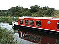 Canal boat heading east, near Glasgow bridge - geograph.org.uk - 1518219.jpg