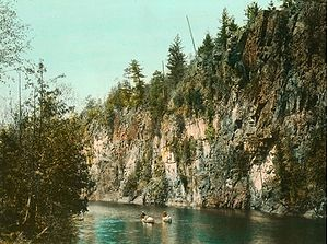 Algonquin Provincial Park - A hand-coloured photograph of canoeists in Algonquin Park in the 1920s