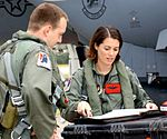 Capt. Nicole Malachowski, F-15E female pilot, looks over checklists before flying a sortie 1763646018.jpg