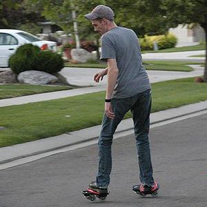 Skurfing (sport) - A person street skurfing
