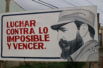 "Cuban propaganda poster proclaiming a quote from Castro: ""Luchar contra lo imposible y vencer"" (""To fight against the impossible and win"") Castro sign.jpg"