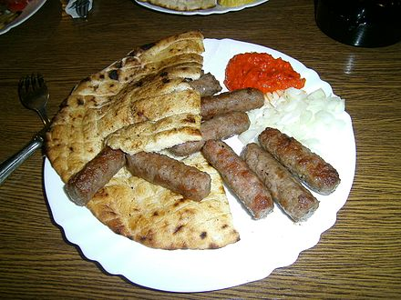 Cevapi, or Cevapcici, the national dish of Serbia, served with ajvar Cevapcici Bosnia (10675837796).jpg