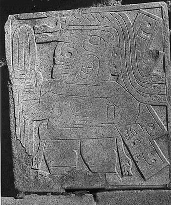 Stone carving from Chavin de Huantar, dated to circa 1000 BC, showing a figure carrying what is thought to be the San Pedro cactus Chavin-cactus-stone.jpg