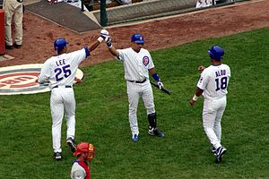 Derrek Lee, Aramis Ramirez and Moisés Alou celebrate.