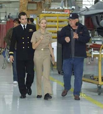 Jordana Spiro - Jordana Spiro goes over a scene for JAG with Chris Beetem (left) and director Vern Gillum (right) in 2005