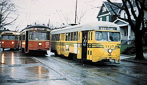 Streetcars in Cincinnati - A then-new Cincinnati trolley coach with streetcars of two different generations, in the final days of service