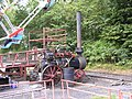 Clayton & Shuttleworth 3NHP portable engine 44141 'Olive' (1911) on big wheel, Hollycombe, Liphook 3.8.2004 P8030056 (10353817053).jpg