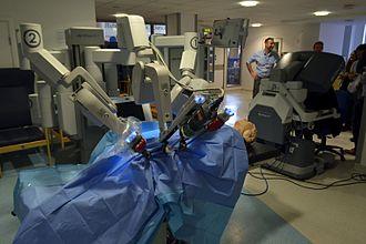 Da Vinci Surgical System - da Vinci patient-side component (left) and surgeon console (right)