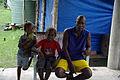 Cocoa farmer David Kebu Jnr sits with is son Snider and daughter Hadasha. (10687084365).jpg