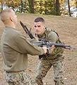 Combat knife attached to gun.jpg