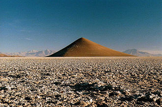 Landform - This conical hill in Salar de Arizaro, Salta, Argentina called Cono de Arita constitutes a landform.