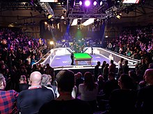 image of snooker table and crowd