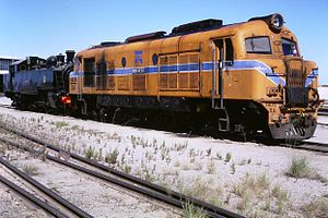 Locomotives of the Western Australian Government Railways - (L–R) narrow gauge locomotives DD592 and XA1403 Wanbiri, both stabled at Forrestfield Yard, 1986.  The track in the foreground is standard gauge track.