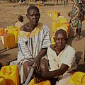 Dabora Alek, right, has waited two hours to collect water (12451605083).jpg