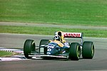 Damon Hill - Williams FW15C during practice for the 1993 British Grand Prix (32873554133).jpg