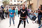 Dancing and singing to forget the pain of Syrias conflict (11235994366).jpg