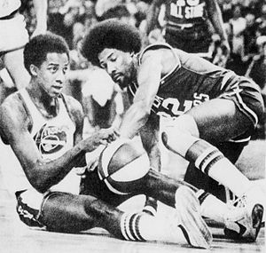 David Thompson (basketball) - Thompson (left) and Julius Erving vying for the basketball in 1976.