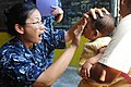 Defense.gov News Photo 110501-F-CF975-115 - U.S. Navy Lt. Eva Chou an ophthalmologist exams the eyes of a 7-month-old patient at a medical clinic at Sagrado Corzon de Jesus School in Paita.jpg