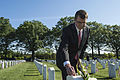 Defense Secretary Ash Carter leaves a challenge coin at the gravesite of Army Spc. Christopher David Horton at Arlington National Cemetery in Arlington, Va., May 22, 2015 150522-D-AF077-033c.jpg
