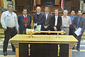 Designer Grant Schreiber reviews the old Parliamentary Mace with a team from the South African Parliament, 2004.jpg