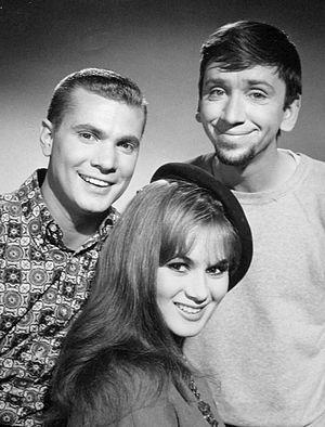 """The Many Loves of Dobie Gillis - Dobie Gillis (Dwayne Hickman, left), Maynard G. Krebs (Bob Denver, right) and one of Dobie's """"many loves"""", Yvette LeBlanc (Danielle De Metz), in a still from the Dobie Gillis episode """"Parlez-Vous English"""", originally aired December 27, 1960"""