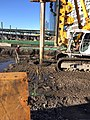 Drilling of foundation piles that will support a personnel footbridge spanning across the future LIRR Mid-day Storage Yard. (CQ033, 02-27-2018) (39678910505).jpg