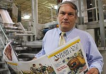 Edwin Grosvenor supervises the printing of American Heritage Magazine