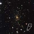Einstein's cross J1011+0143 in galaxy cluster RXC J2211.7-0350.jpg