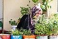 Elderly Woman with Flower Pots on Balcony - Gaziantep (Antep) - Turkey (5769009790).jpg