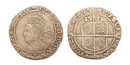 "Silver sixpence, struck 1593, identifying Elizabeth as ""by the Grace of God Queen of England, France, and Ireland"" England Queen Elizabeth I sixpence 1593.jpg"