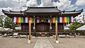 Exterior facade of Kannon Hall Buddhist temple with Goshikimaku Buddhist flags Ninna-ji Kyoto Japan.jpg