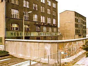 Christian Democratic Union (East Germany) - Exterior of Neue Zeit building, rear view, with the Berlin Wall in the foreground, 1984.