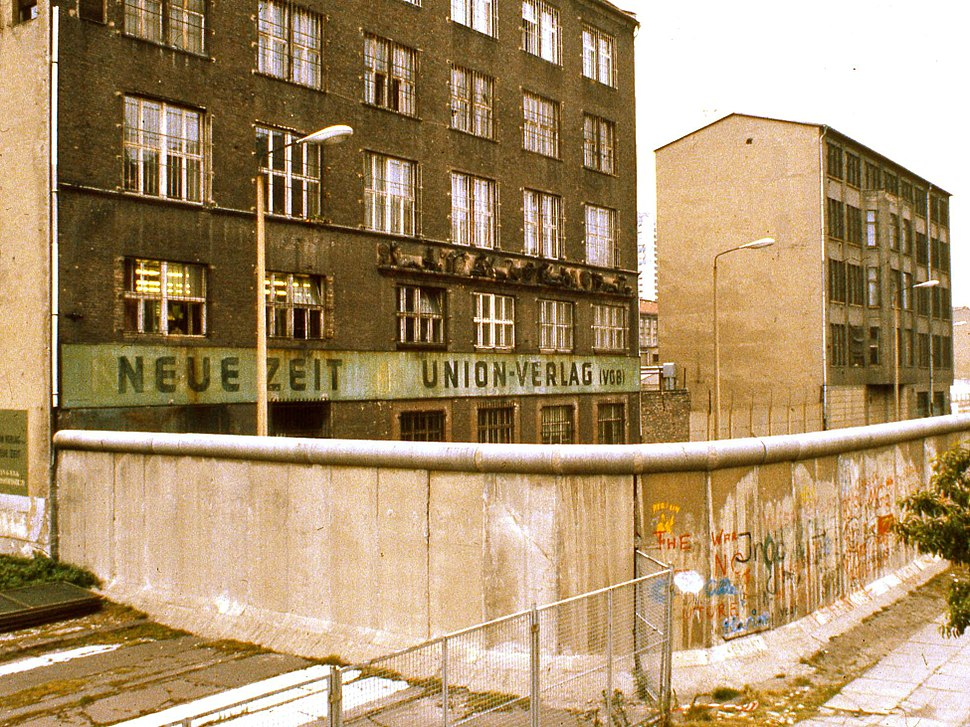 Exterior of East Berlin Neue Zeit newspaper, with Berlin Wall in foreground