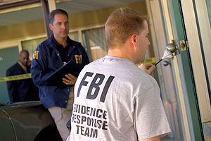 Evidence - An FBI Evidence Response Team gathering evidence by dusting an area for fingerprints