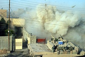 Second Battle of Fallujah - An M1 Abrams fires its main gun into a building to provide suppressive counterfire against insurgents.