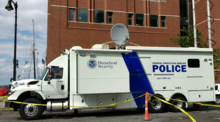 A Federal Protective Service communications vehicle protecting the John Joseph Moakley United States Courthouse during Sail Boston 2017.
